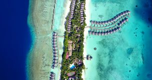 V09564 five 5 star resort water bungalows in Maldives with drone aerial flying view on white sand beach on tropical Stock Photos
