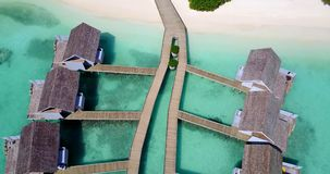 V09427 five 5 star resort water bungalows in Maldives with drone aerial flying view on white sand beach on tropical Stock Photos