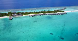 V09467 five 5 star resort water bungalows in Maldives with drone aerial flying view on white sand beach on tropical. Five 5 star resort water bungalows in Royalty Free Stock Images