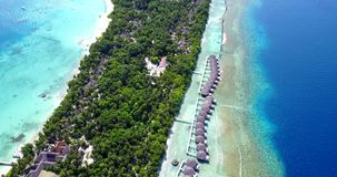 V09524 five 5 star resort water bungalows in Maldives with drone aerial flying view on white sand beach on tropical Royalty Free Stock Photos