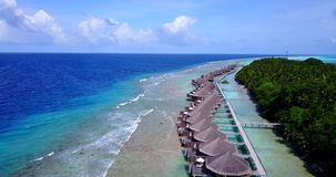 V09561 five 5 star resort water bungalows in Maldives with drone aerial flying view on white sand beach on tropical. Five 5 star resort water bungalows in Stock Image