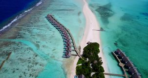 V09437 five 5 star resort water bungalows in Maldives with drone aerial flying view on white sand beach on tropical Royalty Free Stock Image