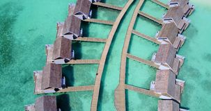 V09432 five 5 star resort water bungalows in Maldives with drone aerial flying view on white sand beach on tropical Stock Photo