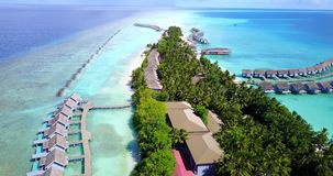 V09507 five 5 star resort water bungalows in Maldives with drone aerial flying view on white sand beach on tropical. Five 5 star resort water bungalows in Royalty Free Stock Photography