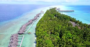 V09503 five 5 star resort water bungalows in Maldives with drone aerial flying view on white sand beach on tropical. Five 5 star resort water bungalows in Royalty Free Stock Images