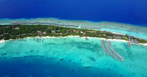 V09472 five 5 star resort water bungalows in Maldives with drone aerial flying view on white sand beach on tropical Stock Photography