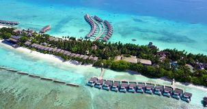 V09519 five 5 star resort water bungalows in Maldives with drone aerial flying view on white sand beach on tropical Royalty Free Stock Photos