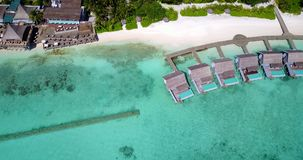 V09417 five 5 star resort water bungalows in Maldives with drone aerial flying view on white sand beach on tropical Royalty Free Stock Images