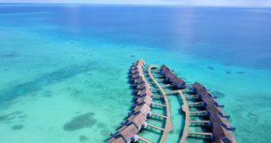 V09510 five 5 star resort water bungalows in Maldives with drone aerial flying view on white sand beach on tropical Stock Image