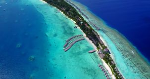 V09482 five 5 star resort water bungalows in Maldives with drone aerial flying view on white sand beach on tropical. Five 5 star resort water bungalows in Stock Photos