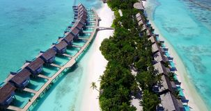 V09543 five 5 star resort water bungalows in Maldives with drone aerial flying view on white sand beach on tropical. Five 5 star resort water bungalows in Royalty Free Stock Photo