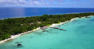 V09447 five 5 star resort water bungalows in Maldives with drone aerial flying view on white sand beach on tropical Royalty Free Stock Photo