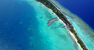 V09481 five 5 star resort water bungalows in Maldives with drone aerial flying view on white sand beach on tropical Stock Photos