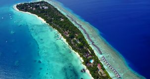 V09487 five 5 star resort water bungalows in Maldives with drone aerial flying view on white sand beach on tropical. Five 5 star resort water bungalows in Royalty Free Stock Photo