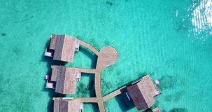 V09512 five 5 star resort water bungalows in Maldives with drone aerial flying view on white sand beach on tropical Stock Photos