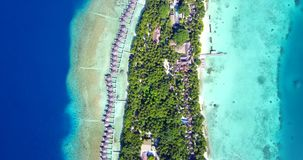 V09520 five 5 star resort water bungalows in Maldives with drone aerial flying view on white sand beach on tropical Stock Photos