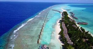 V09421 five 5 star resort water bungalows in Maldives with drone aerial flying view on white sand beach on tropical Royalty Free Stock Photos