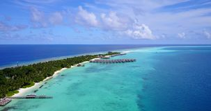 V09454 five 5 star resort water bungalows in Maldives with drone aerial flying view on white sand beach on tropical. Five 5 star resort water bungalows in Royalty Free Stock Images