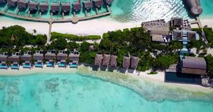 V09412 five 5 star resort water bungalows in Maldives with drone aerial flying view on white sand beach on tropical Royalty Free Stock Photos
