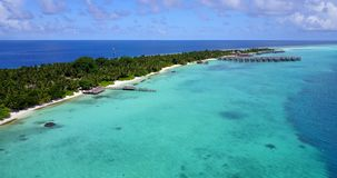 V09451 five 5 star resort water bungalows in Maldives with drone aerial flying view on white sand beach on tropical Stock Photos