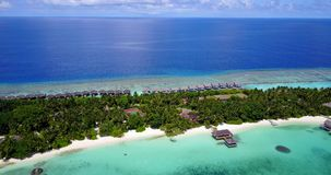 V09462 five 5 star resort water bungalows in Maldives with drone aerial flying view on white sand beach on tropical Stock Image
