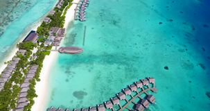 V09530 five 5 star resort water bungalows in Maldives with drone aerial flying view on white sand beach on tropical Royalty Free Stock Image