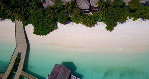 V09424 five 5 star resort water bungalows in Maldives with drone aerial flying view on white sand beach on tropical Stock Photos