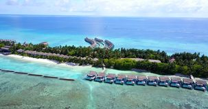 V09517 five 5 star resort water bungalows in Maldives with drone aerial flying view on white sand beach on tropical Stock Photo