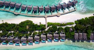 V09560 five 5 star resort water bungalows in Maldives with drone aerial flying view on white sand beach on tropical Royalty Free Stock Photos