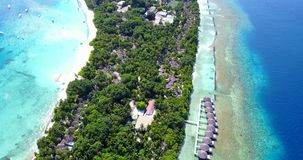 V09525 five 5 star resort water bungalows in Maldives with drone aerial flying view on white sand beach on tropical Stock Photo