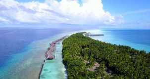 V09500 five 5 star resort water bungalows in Maldives with drone aerial flying view on white sand beach on tropical. Five 5 star resort water bungalows in Royalty Free Stock Photo