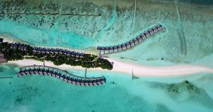 V09485 five 5 star resort water bungalows in Maldives with drone aerial flying view on white sand beach on tropical. Five 5 star resort water bungalows in Stock Photos