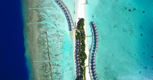 V09442 five 5 star resort water bungalows in Maldives with drone aerial flying view on white sand beach on tropical Royalty Free Stock Photography