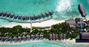 V09570 five 5 star resort water bungalows in Maldives with drone aerial flying view on white sand beach on tropical Royalty Free Stock Photo