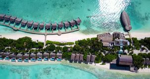 V09573 five 5 star resort water bungalows in Maldives with drone aerial flying view on white sand beach on tropical Royalty Free Stock Images