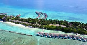 V09518 five 5 star resort water bungalows in Maldives with drone aerial flying view on white sand beach on tropical Royalty Free Stock Photography