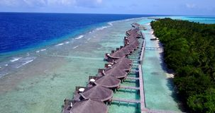 V09571 five 5 star resort water bungalows in Maldives with drone aerial flying view on white sand beach on tropical. Five 5 star resort water bungalows in Royalty Free Stock Images