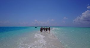 V13825 Five 5 walking beautiful young girls in bikini sunbathing with drone aerial flying view on white sand island Stock Photography