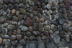 V?gg av oj?mna stenar fotografering för bildbyråer