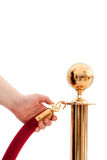 V.I.P only!!!  Hand opening red rope Royalty Free Stock Photo