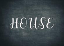 V?lkomna hem- bokst?ver f?r barn f?r familj f?r husbyggnad levande arkivbilder