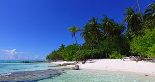 V02028 Maldives beautiful beach background white sandy tropical paradise island with blue sky sea water ocean 4k stock video footage