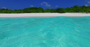 V02034 Maldives beautiful beach background white sandy tropical paradise island with blue sky sea water ocean 4k stock footage