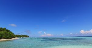 V02139 Maldives beautiful beach background white sandy tropical paradise island with blue sky sea water ocean 4k stock video footage