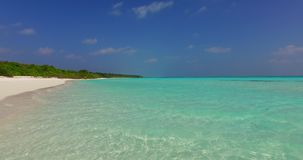 V02210 Maldives beautiful beach background white sandy tropical paradise island with blue sky sea water ocean 4k stock footage