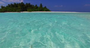V02254 Maldives beautiful beach background white sandy tropical paradise island with blue sky sea water ocean 4k stock video