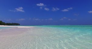 V02275 Maldives beautiful beach background white sandy tropical paradise island with blue sky sea water ocean 4k. Maldives beautiful beach background white sandy stock video footage