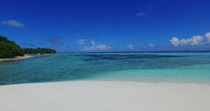 V02278 Maldives beautiful beach background white sandy tropical paradise island with blue sky sea water ocean 4k. Maldives beautiful beach background white sandy stock footage