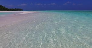 V02996 Maldives beautiful beach background white sandy tropical paradise island with blue sky sea water ocean 4k stock video footage