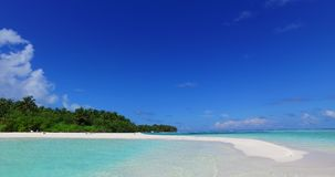V02060 Maldives beautiful beach background white sandy tropical paradise island with blue sky sea water ocean 4k. Maldives beautiful beach background white sandy Royalty Free Stock Images